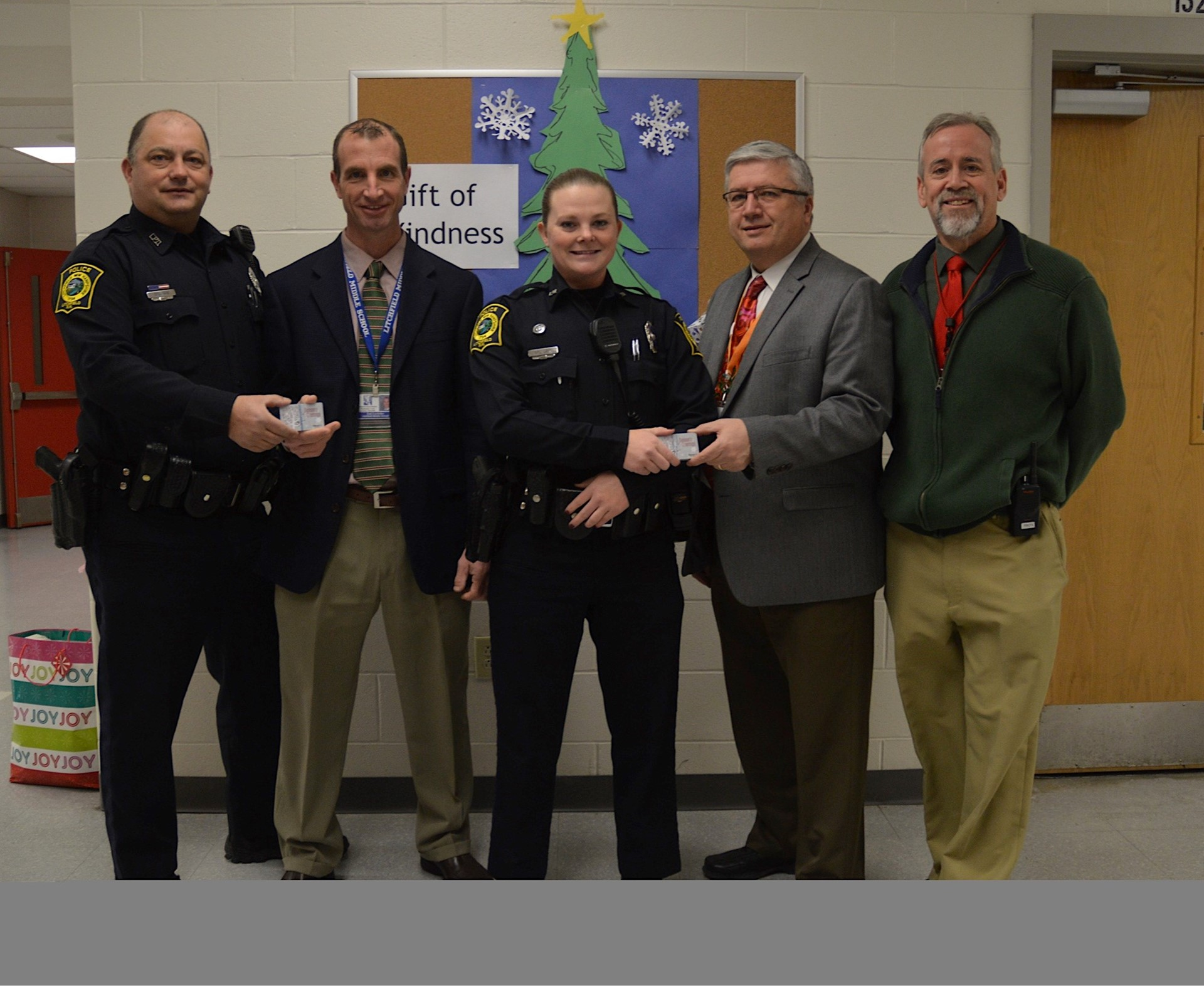 Litchfield Police with School Admin Presenting Gifts for Students