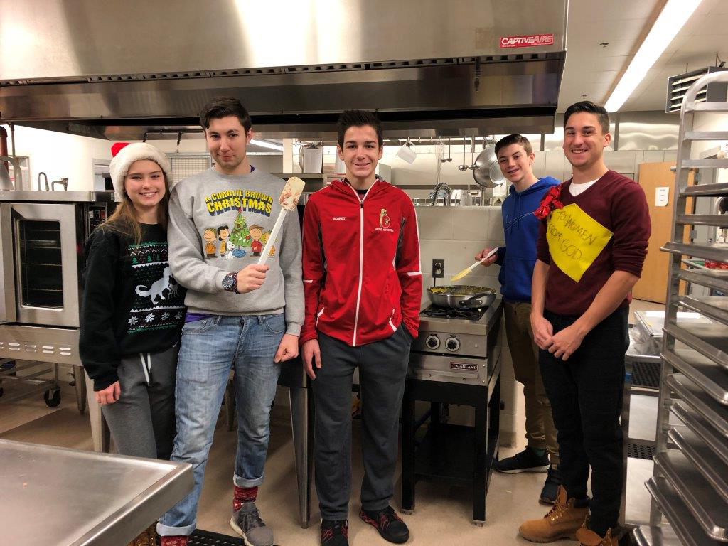 Student Council members help cook in the kitchen.