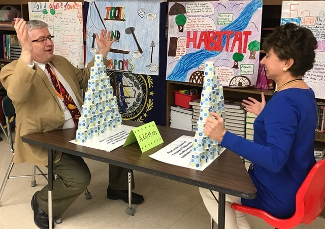 Mr. Thompson and Ms. Faro - cup stacking challenge