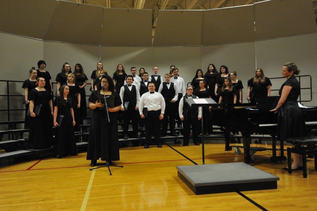 Chorus singers led by Ms. Pennington
