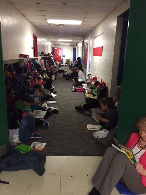 Grade 2 reading quietly including Mrs. Mic's class
