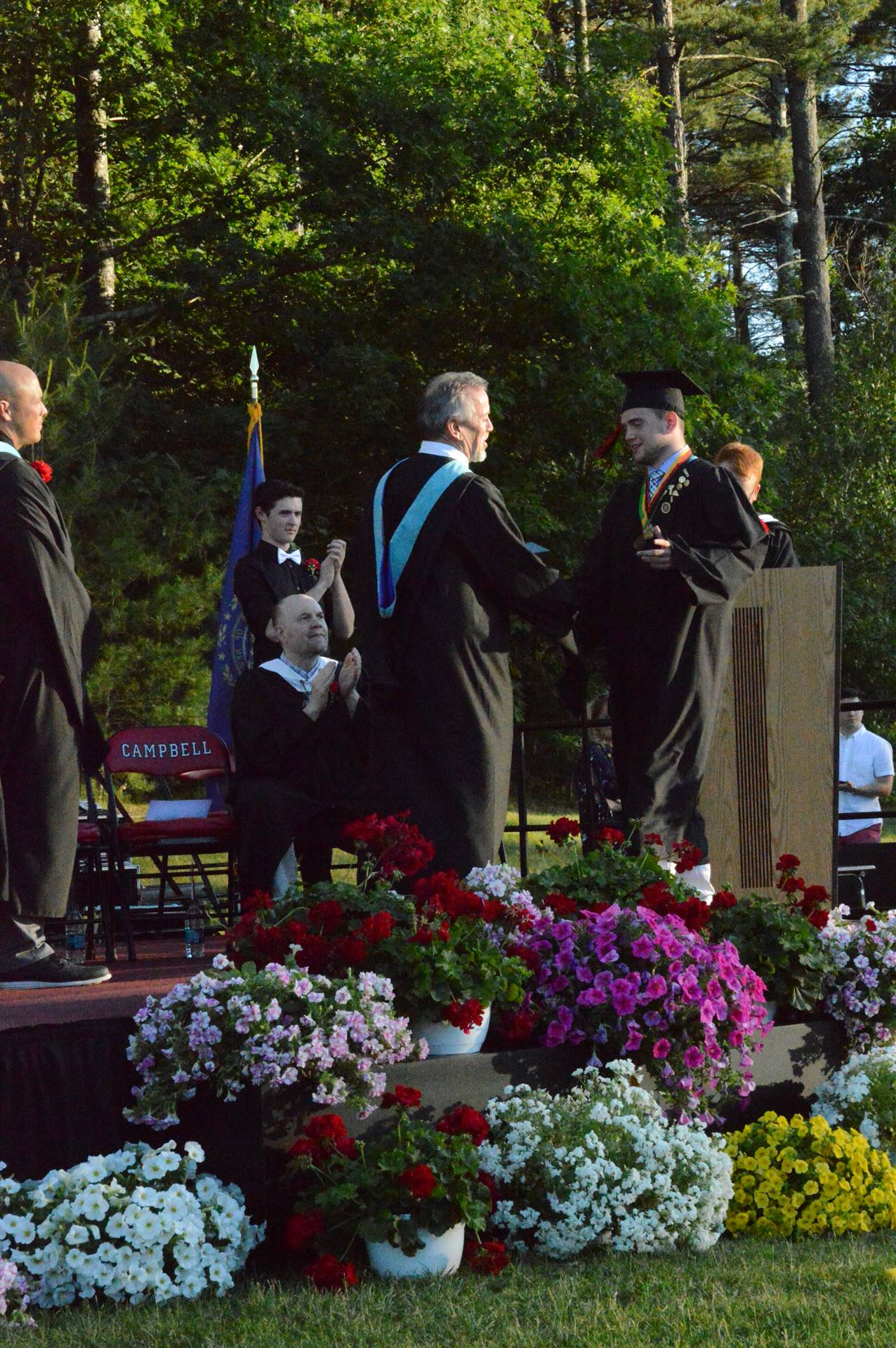 Shawn G. Being presented his diploma