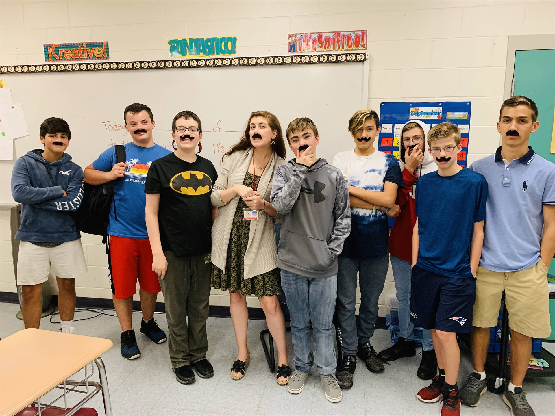 Spanish class wearing los mostachos