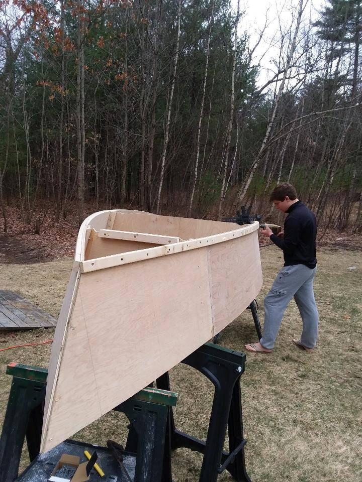 Aidan H working on his boat