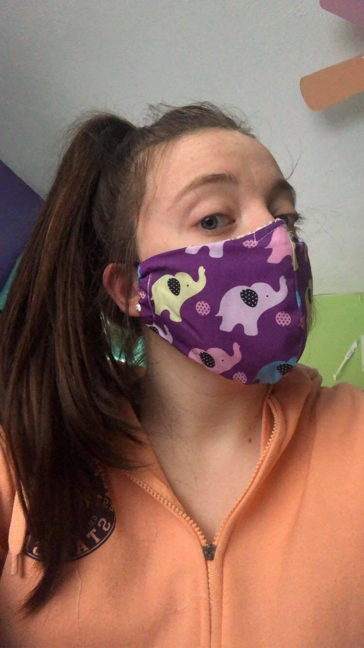 Tori modeling her mask
