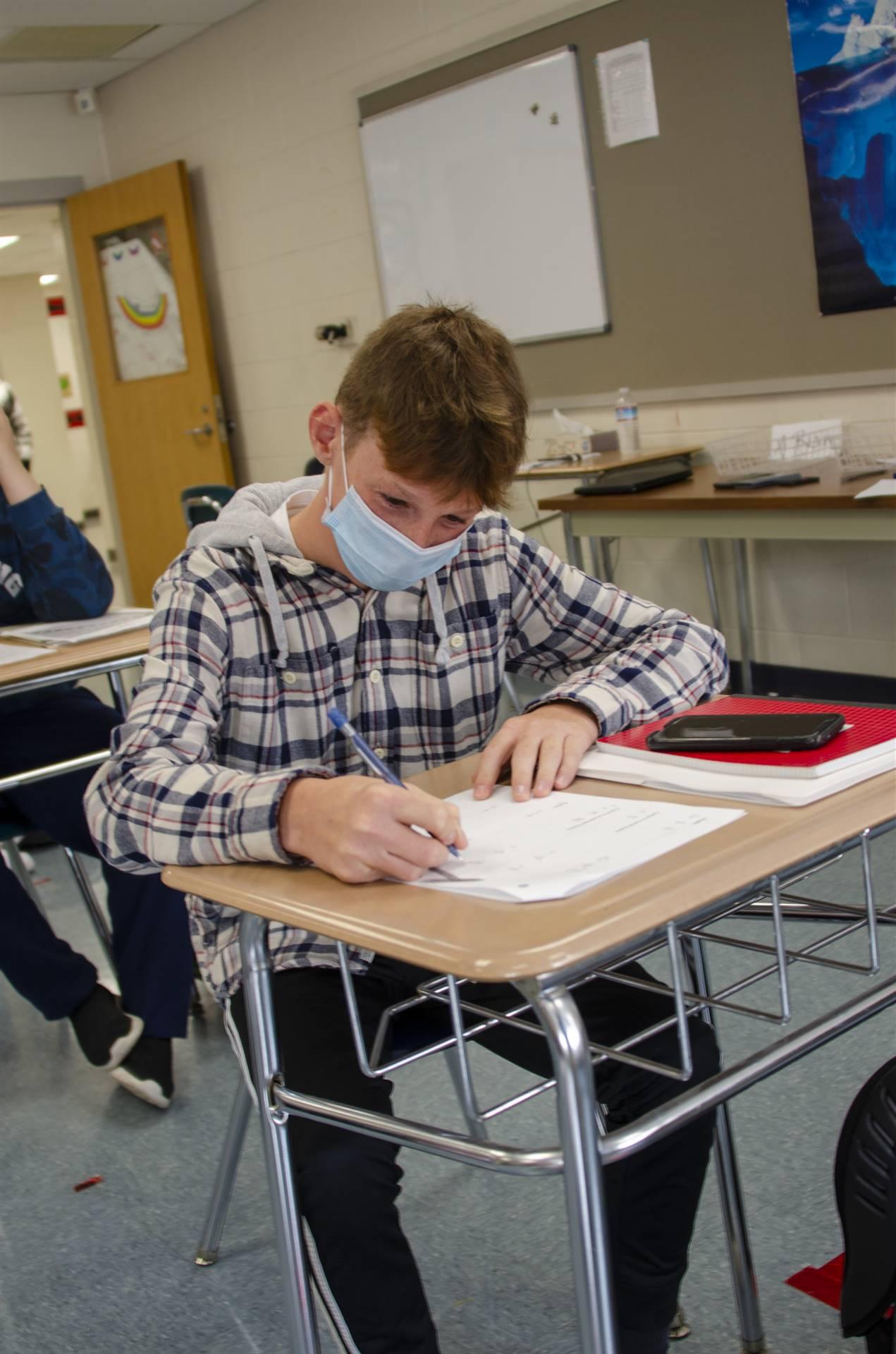 Tyler working hard in math